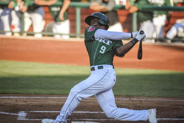 Mike Moore | The Journal Gazette TinCaps right fielder Dwanya Williams-Sutton batting in the first inning against Lake County at Parkview Field on Thursday.