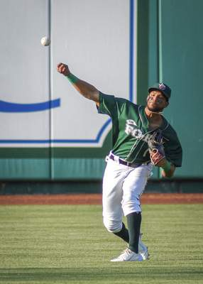Mike Moore | The Journal Gazette After catching a pop-fly, TinCaps center fielder Reinaldo Ilarraza throws to third base in the first inning against Lake County at Parkview Field on Thursday.