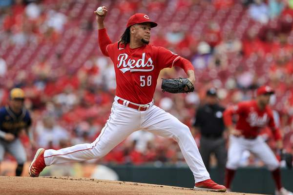 Cincinnati Reds' Luis Castillo throws during the first inning of a baseball game against the Milwaukee Brewers in Cincinnati, Thursday, June 10, 2021. (AP Photo/Aaron Doster)