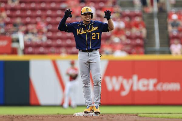 Milwaukee Brewers' Willy Adames reacts after hitting an RBI ground-rule double during the sixth inning of a baseball game against the Cincinnati Reds in Cincinnati, Thursday, June 10, 2021. (AP Photo/Aaron Doster)