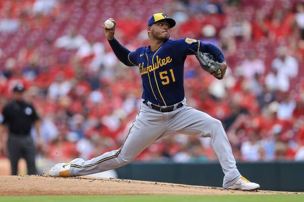 Milwaukee Brewers' Freddy Peralta throws during the first inning of a baseball game against the Cincinnati Reds in Cincinnati, Thursday, June 10, 2021. (AP Photo/Aaron Doster)