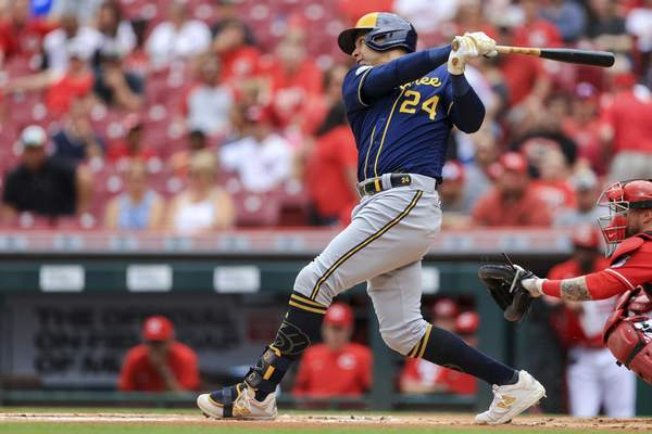 Milwaukee Brewers' Avisail Garcia hits an RBI single during the first inning of a baseball game against the Cincinnati Reds in Cincinnati, Thursday, June 10, 2021. (AP Photo/Aaron Doster)