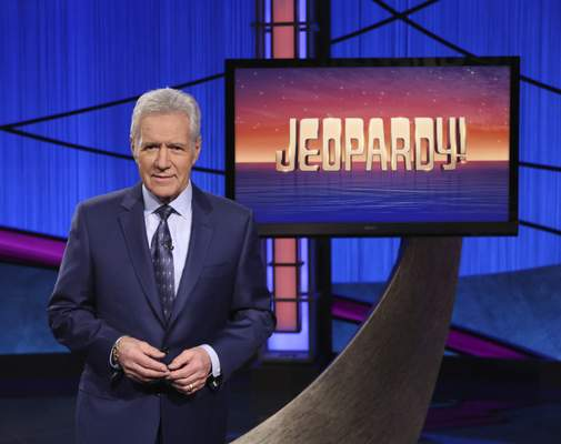 FILE - This image released by Jeopardy! shows Alex Trebek, host of the game show Jeopardy! Filling the void left by Trebek after 37 years involves sophisticated research and a parade of guest hosts doing their best to impress viewers and the studio that will make the call. (Jeopardy! via AP)