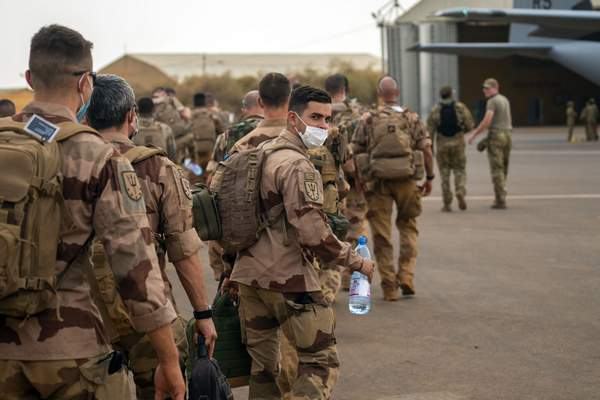 French Barkhane force soldiers who wrapped up a four-month tour of duty in the Sahel board a US Air Force C130 transport plane, leave their base in Gao, Mali Wednesday June 9, 2021. (AP Photo/Jerome Delay)