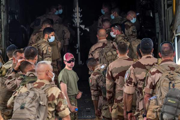 French Barkhane force soldiers who wrapped up a four-month tour of duty in the Sahel board a US Air Force C130 transport plane, leave their base in Gao, Mali, Wednesday June 9, 2021. (AP Photo/Jerome Delay)