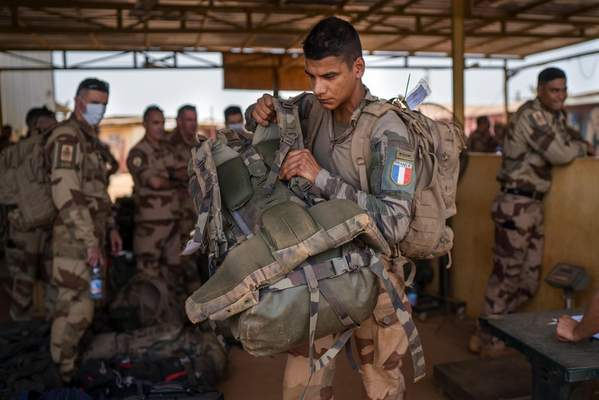 French Barkhane force soldiers who wrapped up a four-month tour of duty in the Sahel leave their base in Gao, Mali Wednesday June 9, 2021. (AP Photo/Jerome Delay)