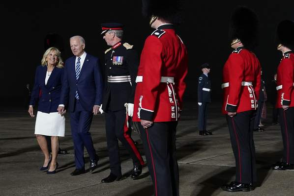 President Joe Biden and Jill Biden are escorted by Colonel Edward Bolitho, Lord Lieutenant of Cornwall, after stepping off Air Force One at Cornwall Airport Newquay, Wednesday, June 9, 2021, in Newquay, England. (AP Photo/Patrick Semansky)