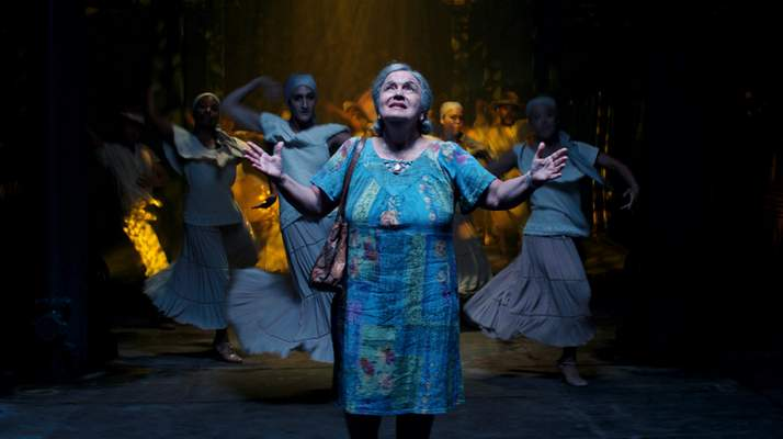 This image released by Warner Bros. Pictures shows Olga Merediz in a scene from In the Heights. (Warner Bros. via AP)