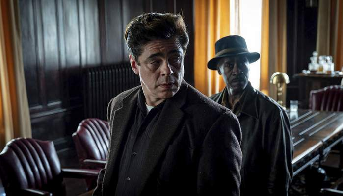 This image released by Warner Bros. Pictures shows Benicio del Toro, center, and Don Cheadle in a scene from No Sudden Move, a film that will premiere as the centerpiece gala at the Tribeca Film Festival next month. (Claudette Barius/Warner Bros. Pictures via AP)