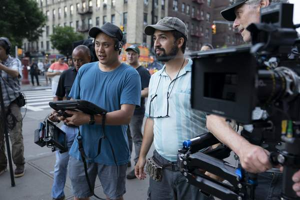 This image released by Warner Bros. Pictures shows director John Chu, left, and Lin-Manuel Miranda on the set of In the Heights. (Macall Polay/Warner Bros. via AP)