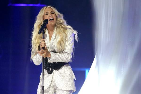 Carrie Underwood performs I Wanna Remember with NEEDTOBREATHE at the CMT Music Awards on Wednesday, May 5, 2021, in Nashville, Tenn. (AP Photo/Mark Humphrey)