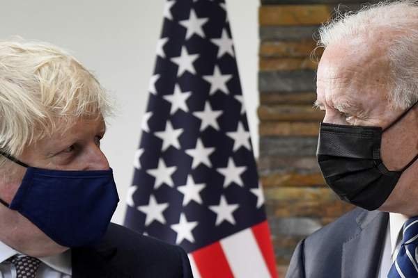 Associated Press President Joe Biden talks with Britain's Prime Minister Boris Johnson on Thursday in Cornwall, England, during their meeting ahead of the G-7 summit.