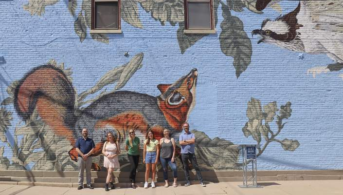 CourtesyBrett Frauhiger  University of Saint Francis professor Tim Parsley and severalstudents involved in the Creative Arts program recently dedicated this piece at1217 Broadway.