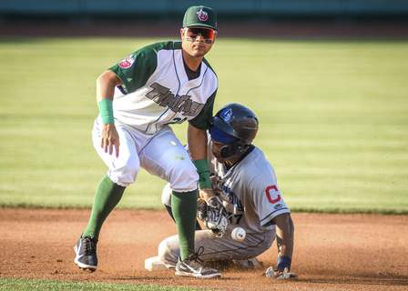 Mike Moore   The Journal Gazette  Captains center fielder Quentin Holmes slides safely into second base as TinCaps shortstop Justin Lopez misses the throw in the first inning Friday night.