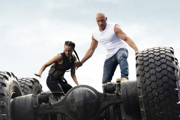 This image released by Universal Pictures shows Nathalie Emmanuel, left, and Vin Diesel in a scene from F9. (Giles Keyte/Universal Pictures via AP)
