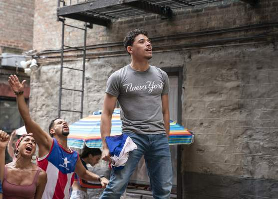 This image released by Warner Bros. Pictures shows Anthony Ramos in a scene from In the Heights. (Macall Polay/Warner Bros. Pictures via AP)