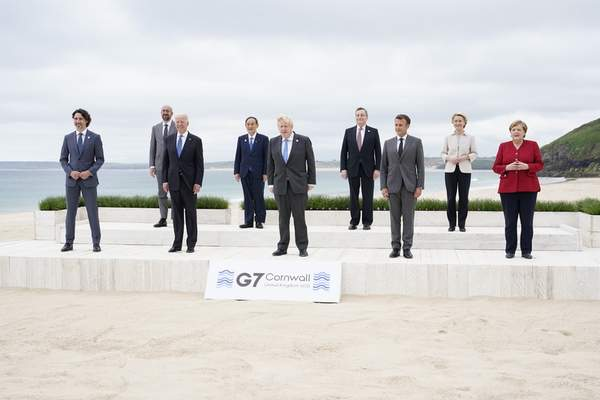 Associated Press Posing for the traditional G-7 group photo Friday  in Carbis Bay, England,  are, from left, Canadian Prime Minister Justin Trudeau, European Council President Charles Michel, U.S. President Joe Biden, Japan's Prime Minister Yoshihide Suga, British Prime Minister Boris Johnson, Italy's Prime Minister Mario Draghi, French President Emmanuel Macron, European Commission President Ursula von der Leyen, and German Chancellor Angela Merkel.