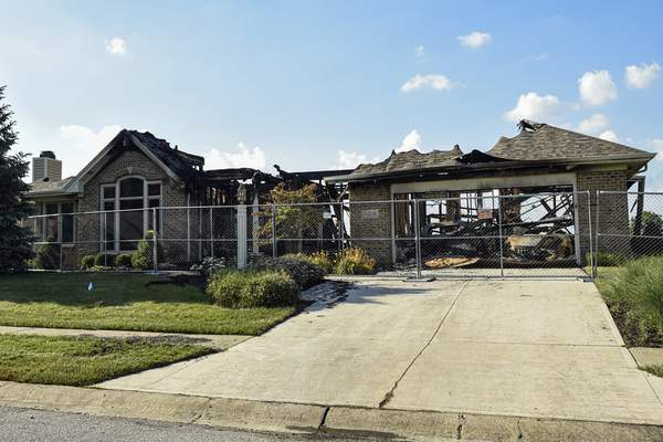 Mike Moore   The Journal Gazette This home on Creekwood Drive was badly damaged by a fire this week.