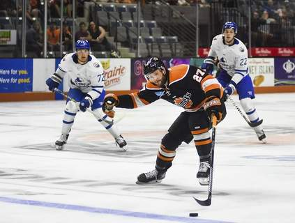 Katie Fyfe | The Journal Gazette Komets forward Shawn Szydlowski chases the puck during the second period against Wichita at Memorial Coliseum on Friday. Fort Wayne won to take a 2-1 series lead.