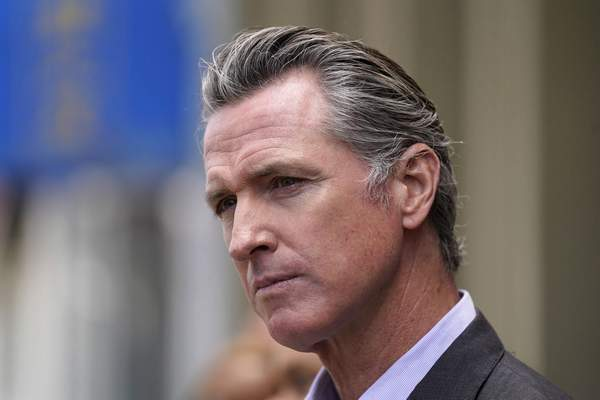 In this June 3, 2021 file photo, California Gov. Gavin Newsom listens to questions during a news conference outside a restaurant in San Francisco. (AP Photo/Eric Risberg, File)