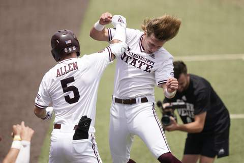 NCAA Notre Dame Mississippi St Baseball Mississippi State's Tanner Allen (5) congratulated by teammate Rowdey Jordan after hitting a home run against Notre Dame during the first inning of an NCAA college baseball super regional game, Saturday, June 12, 2021, in Starkville, Miss. (AP Photo/Rogelio V. Solis) (Rogelio V. Solis STF)