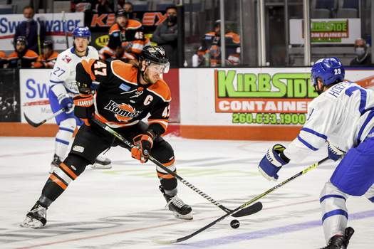 Mike Moore | The Journal Gazette Komets forward A.J. Jenks controls the puck in the first period against Wichita at Memorial Coliseum on Saturday. The fifth and deciding game of the series will be played Monday night at Memorial Coliseum.