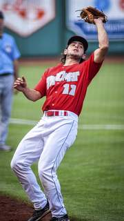 Mike Moore | The Journal Gazette TinCaps third baseman Jonny Homza makes a catch in the first inning Saturday night.
