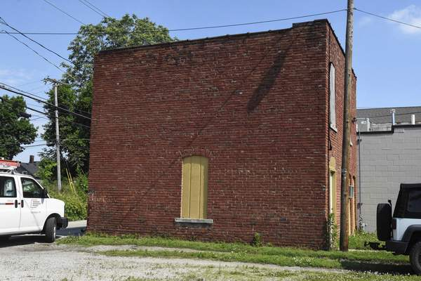 Michelle Davies | The Journal Gazette A carriage house is part of an intact commercial district from bygone days of Fairfield Avenue. A longtime historic preservation planner for the city has plans for the properties.