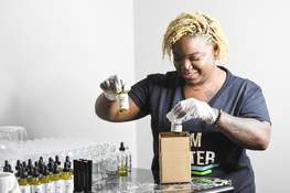 Photos by Katie Fyfe   The Journal Gazette  Symone Weemes, owner of Gem Matter, a beauty products company, puts her  products into shipping boxes.