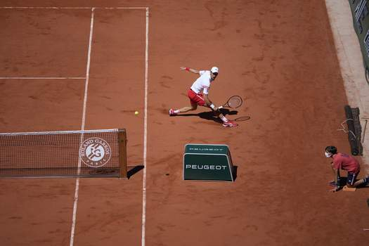 France Tennis French Open Serbia's Novak Djokovic returns the ball to Stefanos Tsitsipas of Greece during their final match of the French Open tennis tournament at the Roland Garros stadium Sunday, June 13, 2021 in Paris. (AP Photo/Christophe Ena) (Christophe Ena STF)