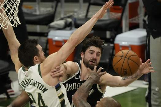 Nets Bucks Basketball Milwaukee Bucks' Pat Connaughton knocks the ball from Brooklyn Nets' Joe Harris during the first half of Game 4 of the NBA Eastern Conference basketball semifinals game Sunday, June 13, 2021, in Milwaukee. (AP Photo/Morry Gash) (Morry Gash STF)