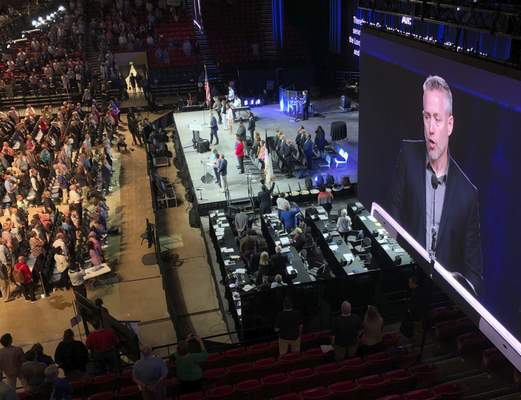 FILE - In this Wednesday, June 13, 2019 file photo, J.D. Greear, president of the Southern Baptist Convention, is shown on a video screen as he addresses the denomination's annual meeting in Birmingham, Ala. (AP Photo/Jay Reeves, File)