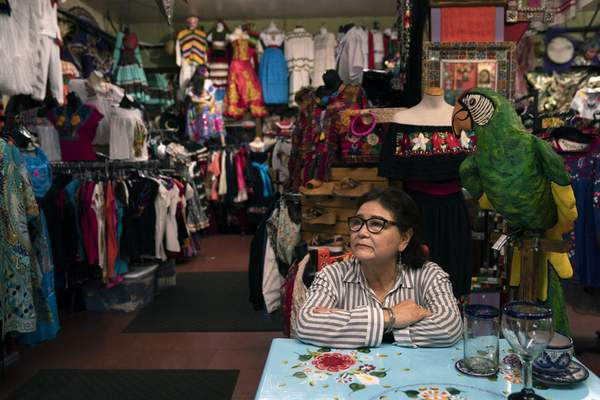 Martha Medina, owner of Olveritas souvenir shop on Olvera Street, sits for a photo in her shop in Los Angeles, Friday, June 4, 2021. (AP Photo/Jae C. Hong)