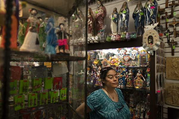 Valerie Hanley, owner of Casa California souvenir shop on Olvera Street and treasurer of the Olvera Street Merchants Association Foundation, stands for a photo in her shop in Los Angeles, Friday, June 4, 2021. (AP Photo/Jae C. Hong)