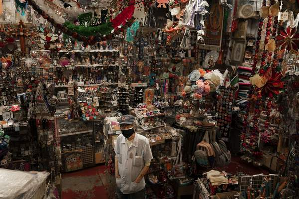Mike Mariscal, owner of Myrosa Enterprises souvenir shop on Olvera Street, stands for a photo in his store in Los Angeles, Friday, June 4, 2021. (AP Photo/Jae C. Hong)