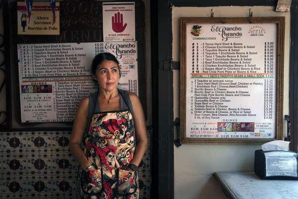 Debbie Briano, a fourth-generation owner of El Rancho Grande Mexican restaurant on Olvera Street, stands for a photo in Los Angeles, Tuesday, June 8, 2021. (AP Photo/Jae C. Hong)