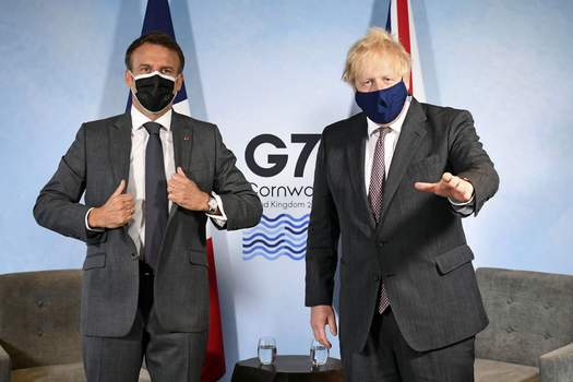 Britain G7 Britain's Prime Minister Boris Johnson, right, and French President Emmanuel Macron ahead of a bilateral meeting during the G7 summit in Cornwall, England, Saturday June 12, 2021. (Stefan Rousseau/Pool via AP) (Stefan Rousseau POOL)
