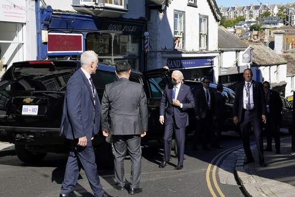 U.S. President Joe Biden, centre, arrives for Mass at Sacred Heart and St. Ia Catholic Church, in St. Ives, southern England, Sunday, June 13, 2021. Biden is in England to attend the G-7 summit. (AP Photo/Patrick Semansky)