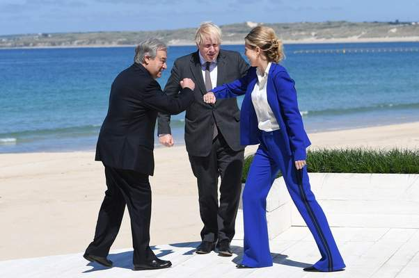 British Prime Minister Boris Johnson and his wife Carrie greet United Nations Secretary General Antonio Guterres, left, during arrivals for the G7 meeting in Carbis Bay, St. Ives, Cornwall, England, Saturday, June 12, 2021. (Stefan Rousseau/Pool via AP)