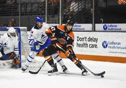 Katie Fyfe | The Journal Gazette Komets forward A.J. Jenks carries the puck near the Wichita goal during the second period Monday night. A screen by Jenks helped the Komets score midway through the period.