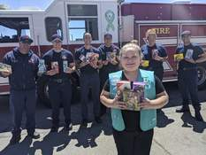 Girl Scouts Unsold Cookies Associated Press This photo provided by Girl Scouts of New Mexico Trails shows a scout donating cookies to firefighters in Rio Rancho, New Mexico, as part of the Hometown Heroes program.  (HONS)
