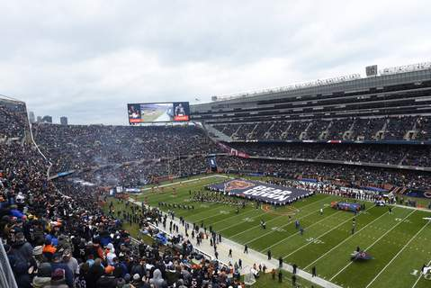 Bears Stadium Football FILE - In this Oct. 28, 2018, file photo, fans wait for an NFL football game at Soldier Field between the New York Jets and the Chicago Bears in Chicago. The Bears have submitted a bid to buy a spacious suburban horse racing track site. Their announcement signals a potential willingness to move out of downtown Soldier Field for a new stadium. Bears President and CEO Ted Phillips says the club wants to purchase the Arlington International Racecourse. (AP Photo/Matt Marton, File) (Matt Marton FRE)