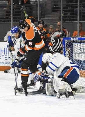 Katie Fyfe | The Journal Gazette  Komets forward Oliver Cooperworks in front of the netduring the second period against Wichita at Memorial Coliseum on Monday.
