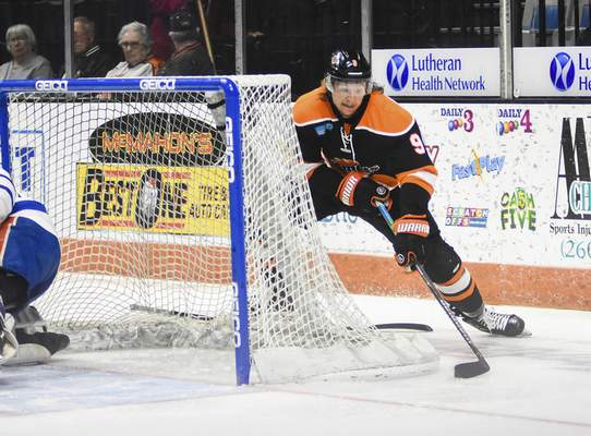 Katie Fyfe | The Journal Gazette  Komets forward Oliver Cooper scores a goal at the beginning the first period against Wichita at Memorial Coliseum on Monday.