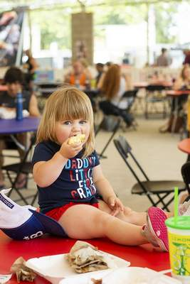 Katie Fyfe | The Journal Gazette  Houston Bohrer, 2, digs in during Rib Fest at Headwaters Park on Saturday.