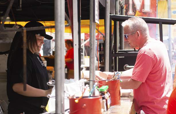 Katie Fyfe | The Journal Gazette Brian Randall orders ribs from Fine Smoke during Rib Fest at Headwaters Park on Saturday.