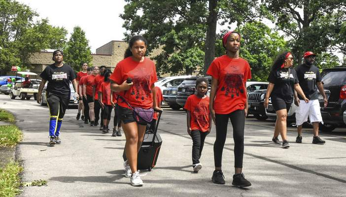Michelle Davies | The Journal Gazette Members of the ALC took part in Saturday's Juneteenth parade.