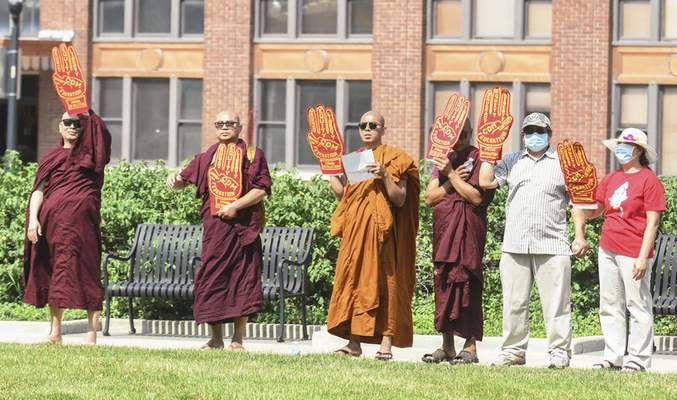Michelle Davies | The Journal Gazette More than 60 people gathered Sunday at the Allen County Courthouse Green to protest the military coup in Myanmar.