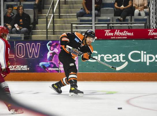 Katie Fyfe | The Journal Gazette  Komets forward Anthony Nellis makes a pass during the first period against the Allen Americans at Memorial Coliseum on Monday.