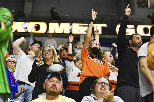 Katie Fyfe | The Journal Gazette  Fans cheer after the Komets score their fourth goal during the first period against the Allen Americans at Memorial Coliseum on Monday.